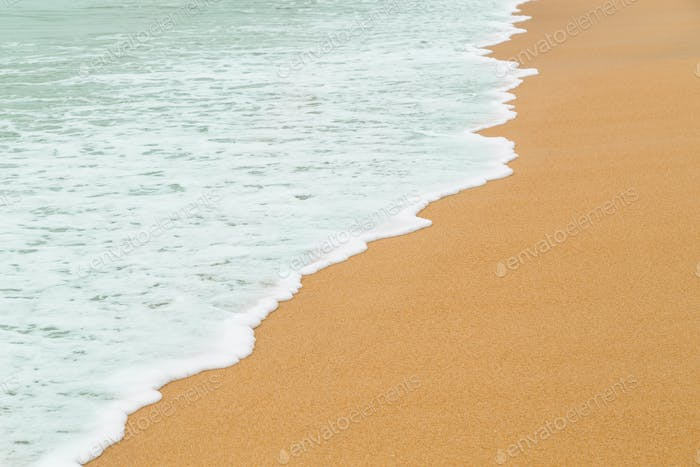 Calm sea waves breaking on sandy beach as background resources