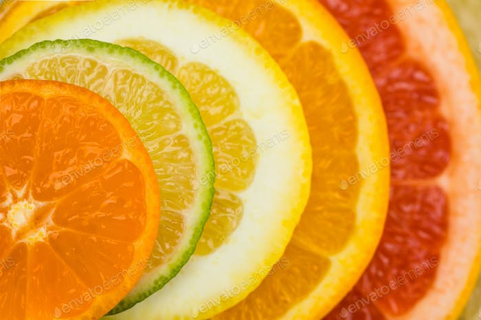close up view of variety of fresh citrus fruits slices