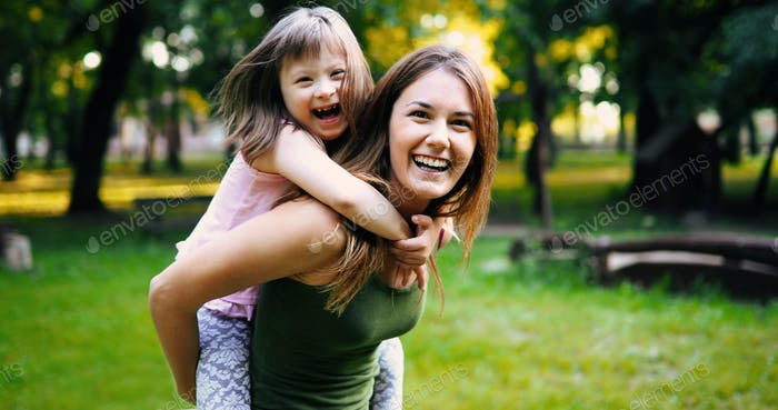 Little girl with special needs enjoy spending time with mother