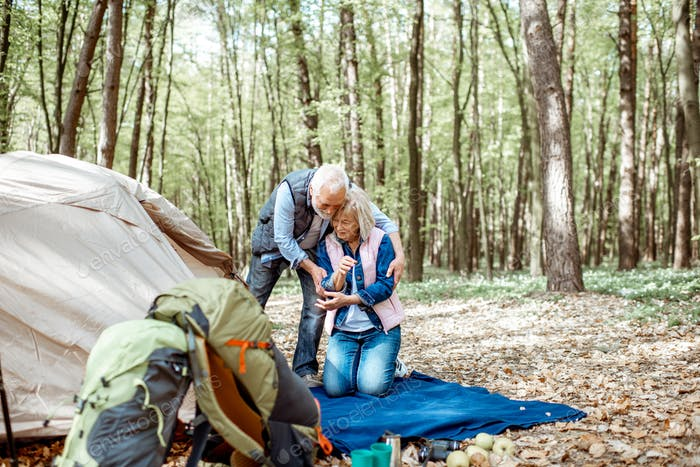 Senior couple camping in the forest