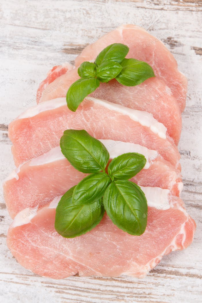 Fresh loin with basil for cooking lunch or dinner
