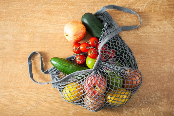 fruits vegetables in reusable mesh cotton bag, plastic free zero waste concept