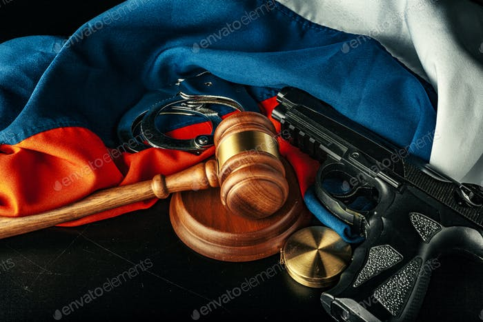 Russian justice. Wooden gavel and russian flag