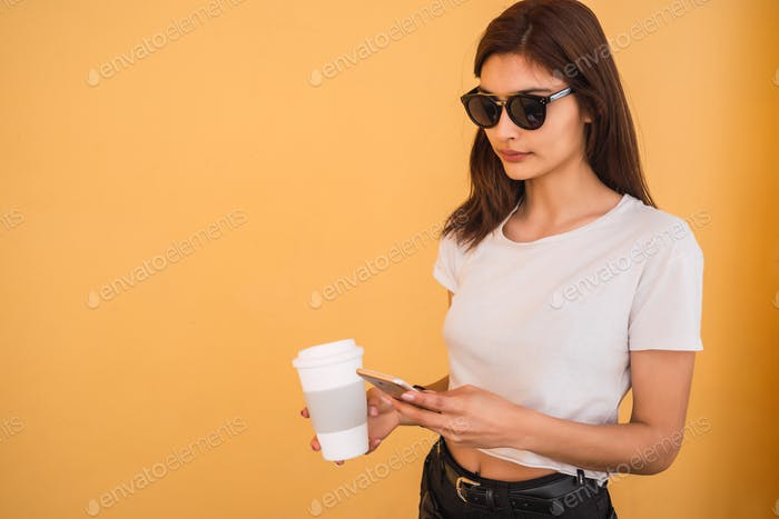 Young woman using her mobile phone.