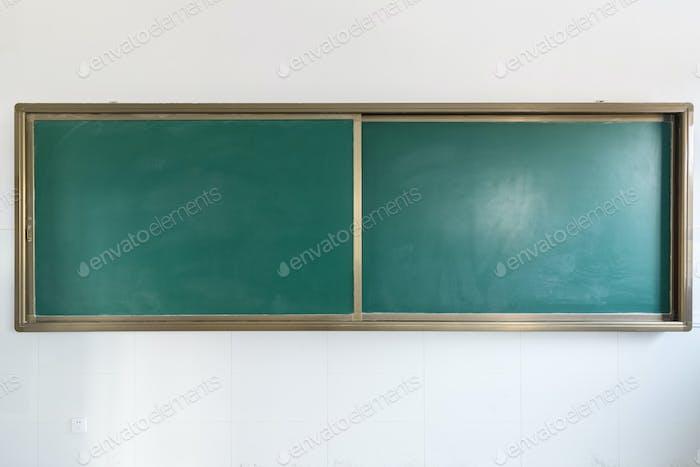 green chalkboard in classroom