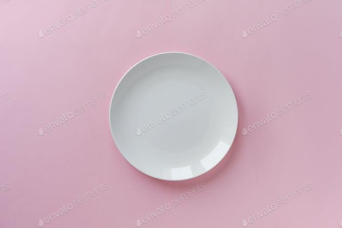 Single empty clean white ceramic plate