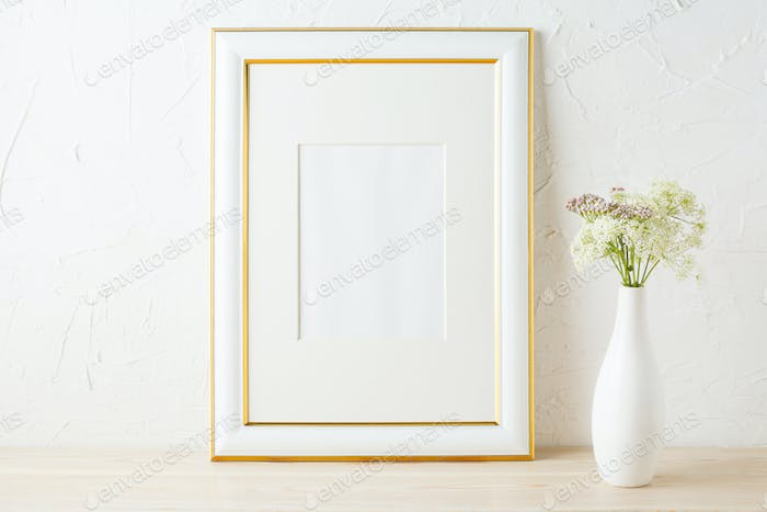 Gold decorated frame mockup with white and pink wildflowers