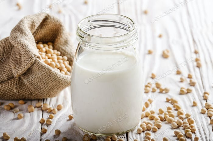 Non-dairy alternative Soy milk or yogurt in mason jar on white w