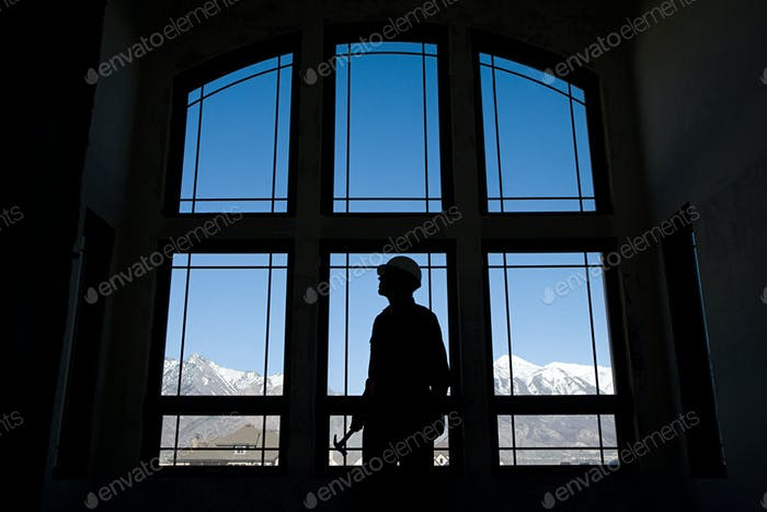 Thumbnail for Silhouette of a builder against a window