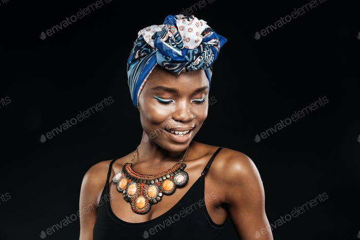 Portrait of a smiling african woman posing in studio