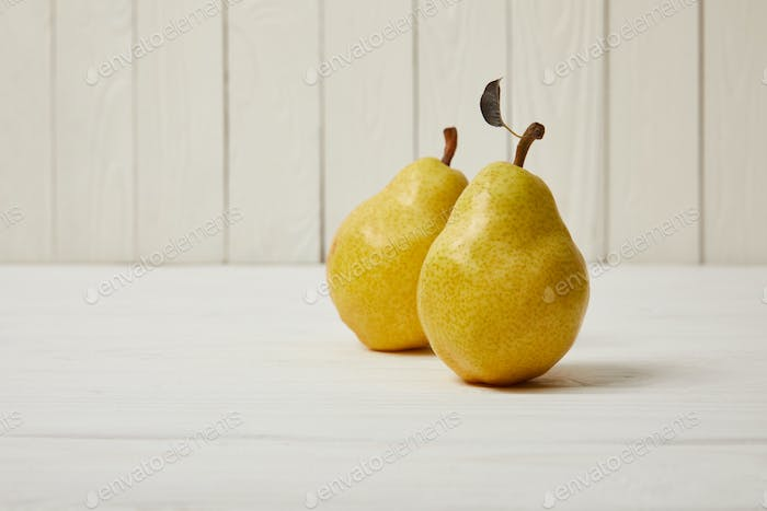 raw fresh yellow pears on wooden background