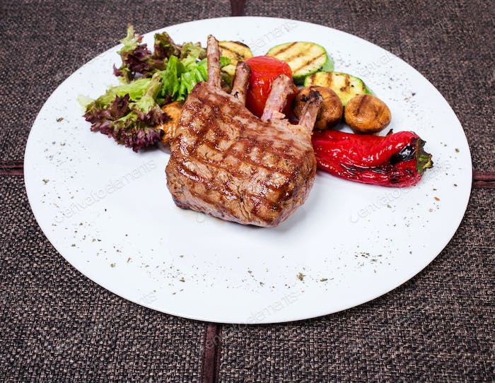Delicious lamb racks with griled vegetables.