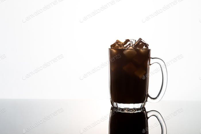 Aromatic hot black coffee in a transparent glass