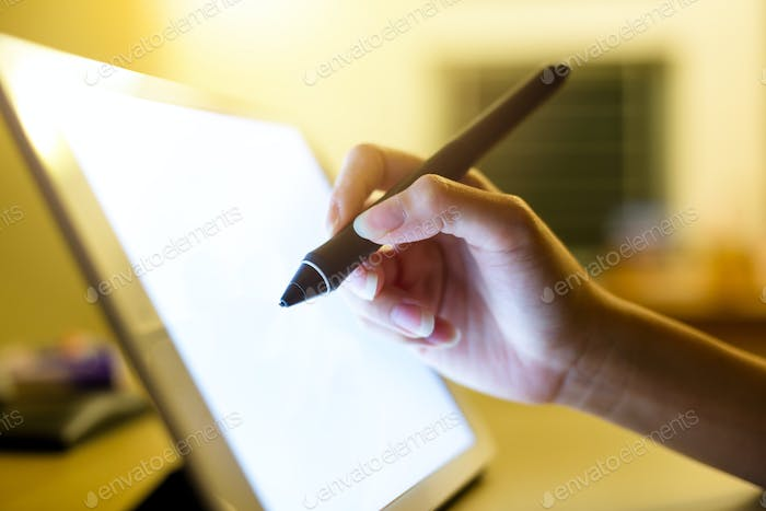 Woman take note on digital tablet pc