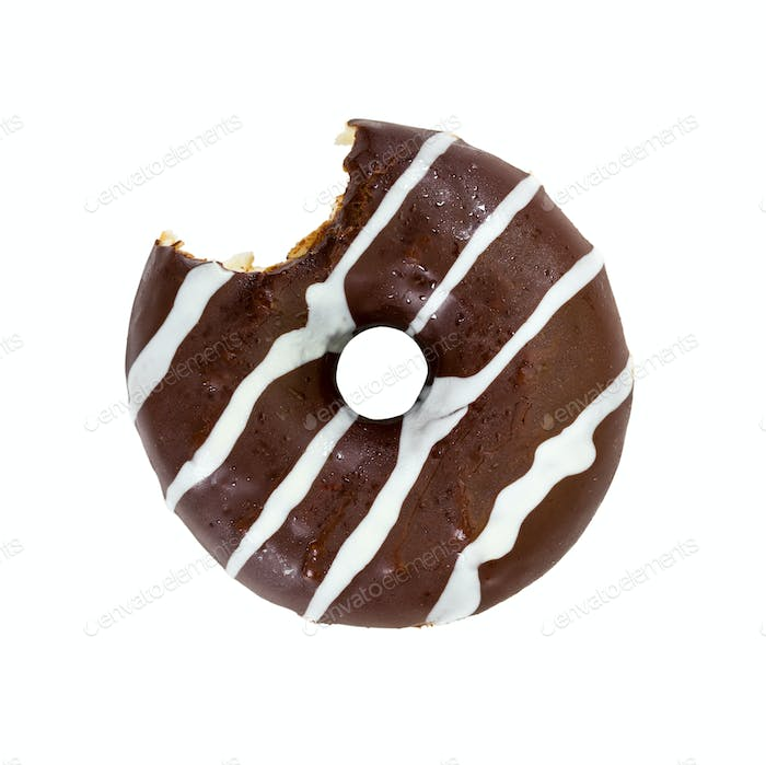 Bitten chocolate donut isolated on white background.