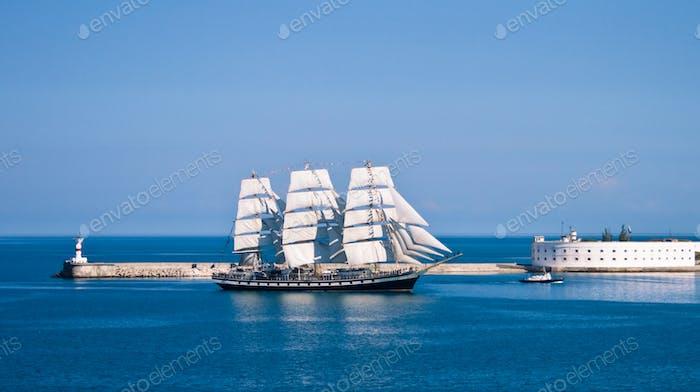 Sailboat entering the bay. Sevastopol