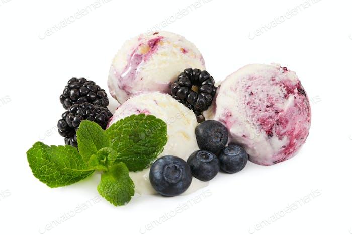 Three balls of ice cream with fresh blueberries, blackberries an