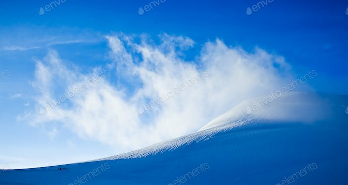 High mountain landscape: glaciers and clouds