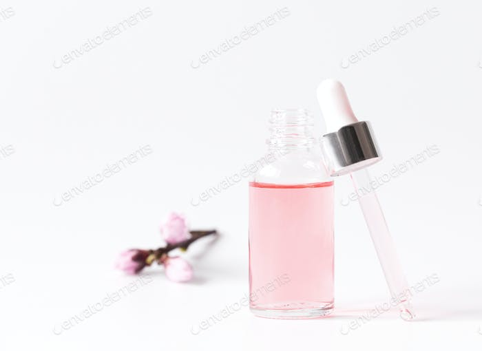 Dropper Bottle with a pipette and pink water.Organic SPA cosmetics .Mock-Up.