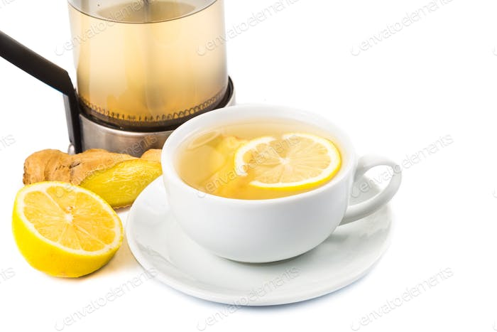 Hot ginger and lemon tea in a cup and filter jar