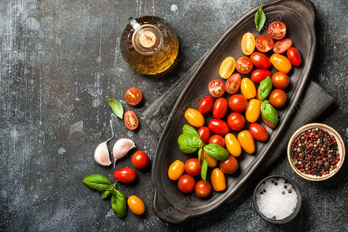 Fresh cherry tomatoes and spices on vintage table