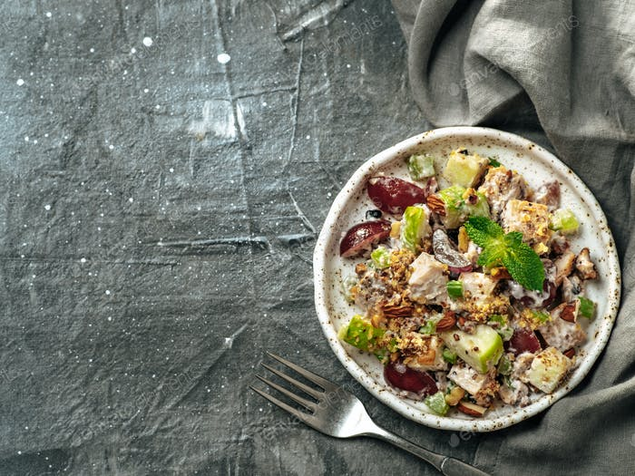 Waldorf salad on gray, copy space, top view