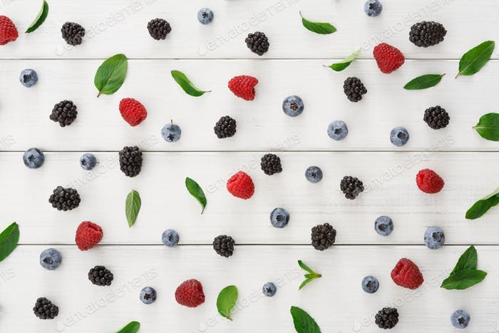 Assorted berries on white wooden table top view