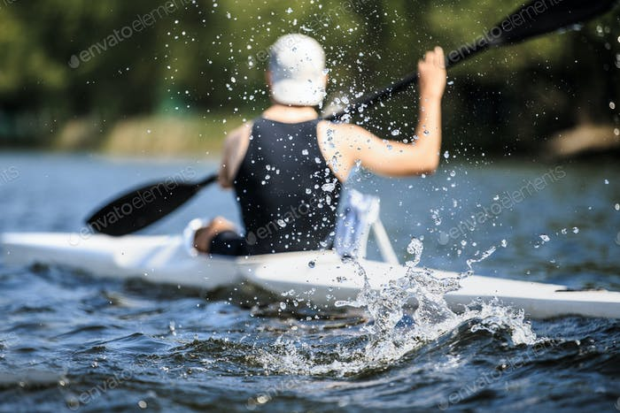 Athlete Rowing Kayak