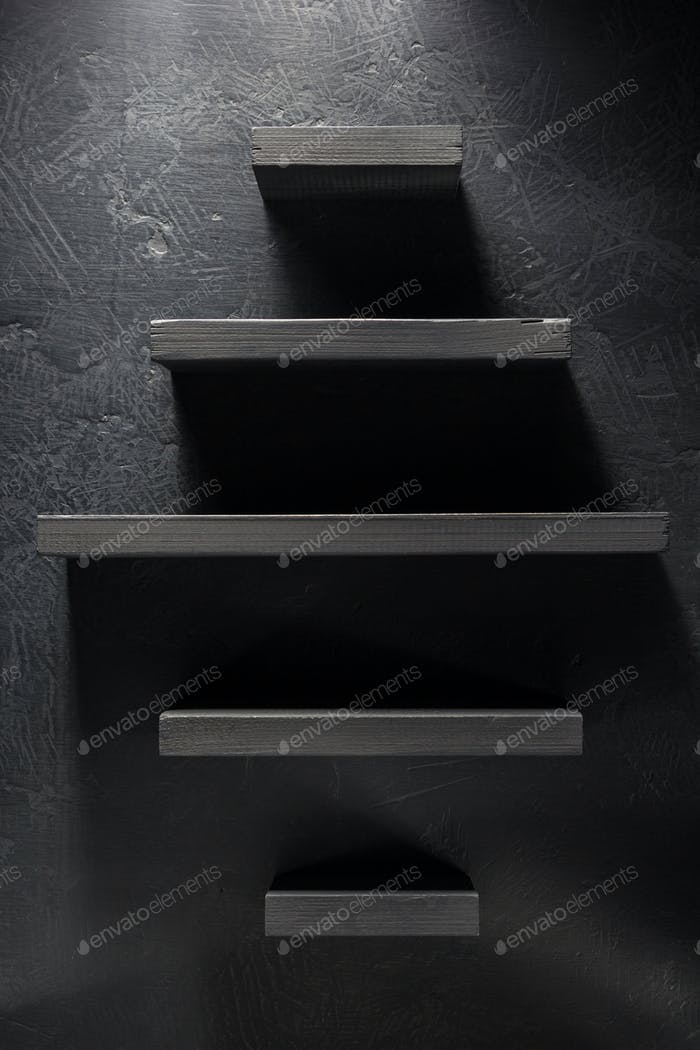 shelf and black wall on wooden