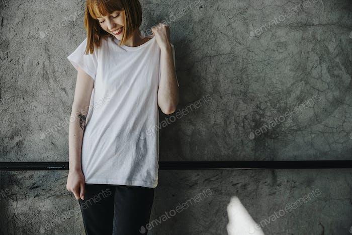 Woman wearing a white T-shirt mockup