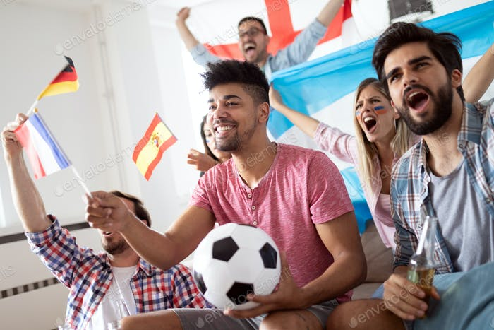 Excited fans of soccer friends celebrating winning match