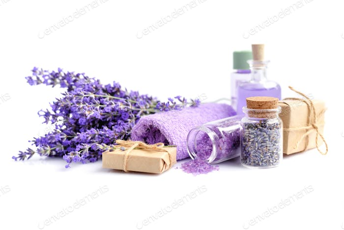 Spa composition with flowers of lavender, salt and bottle of ess