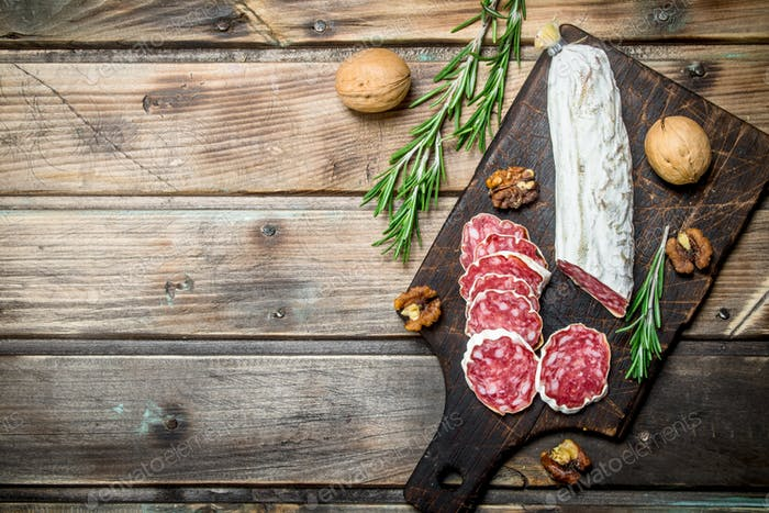 Salami with nuts and rosemary.