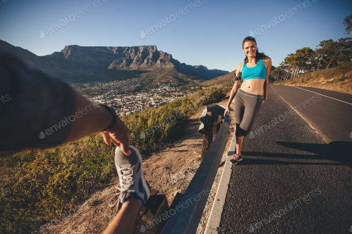 Runners relaxing after morning run