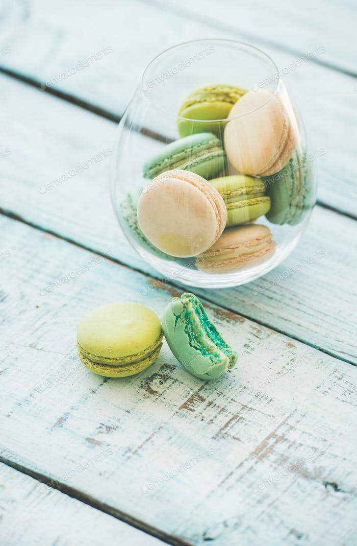 Colorful pastel French macaron biscuits in glass