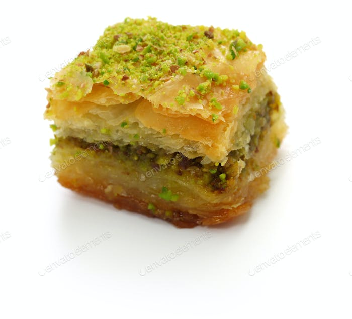 pistachio baklava, fistikli baklava, turkish traditional dessert isolated on white background