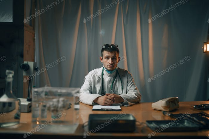 Male psychiatrist at the table, mental hospital