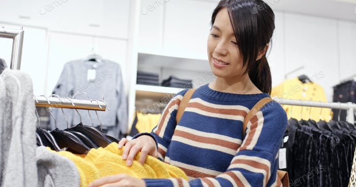 Woman shopping for clothes fashion designer choosing wardrobe