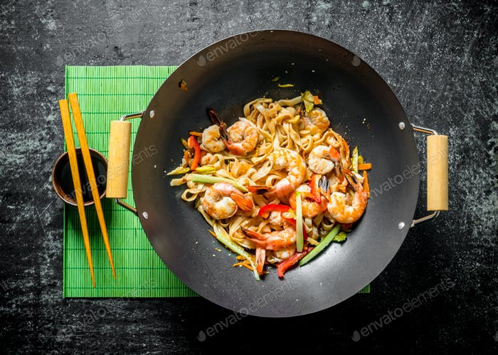 Delicious Chinese Udon noodles with shrimp, sauce and vegetables.
