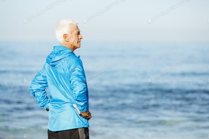 Man standing on beach in sports wear