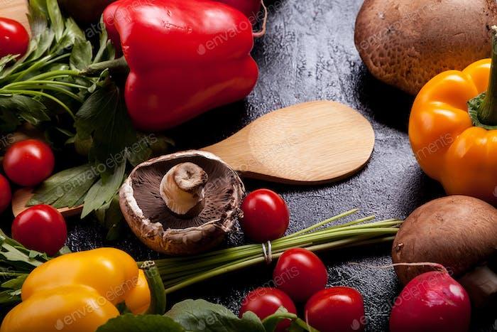 Delicious fresh vegetable on dark wooden background