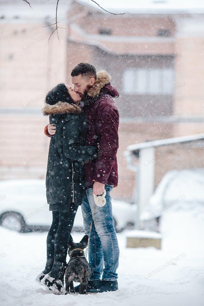 couple posing on a snowy street