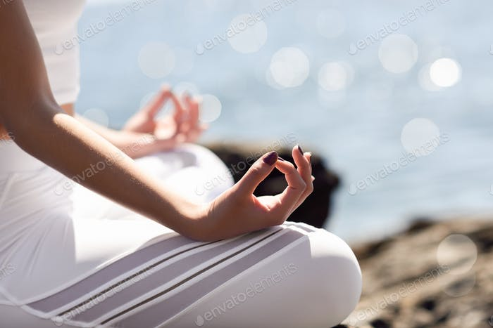 Thumbnail for Young woman doing yoga in the beach wearing white clothes