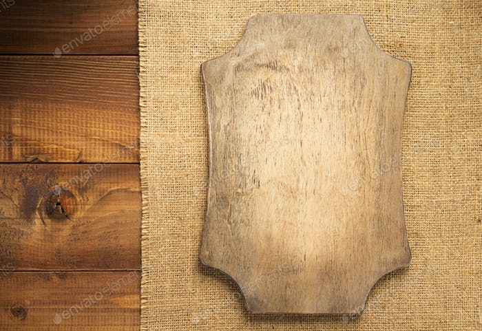 retro sign board at brown wooden background