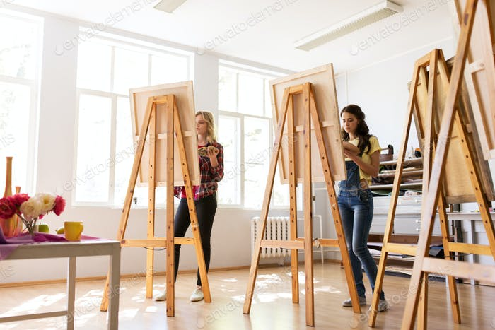 woman artists or students painting at art school