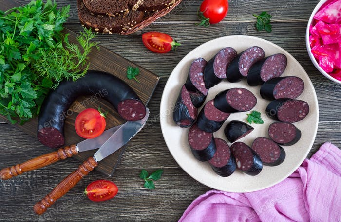 Morsilla - blood sausage. Pieces of Spanish black pudding on a plate. Easter menu.