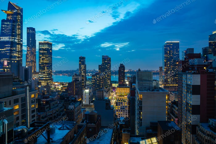 Aerial view of Manhattan skyscrapers lights, New York city, blue sky in the evening