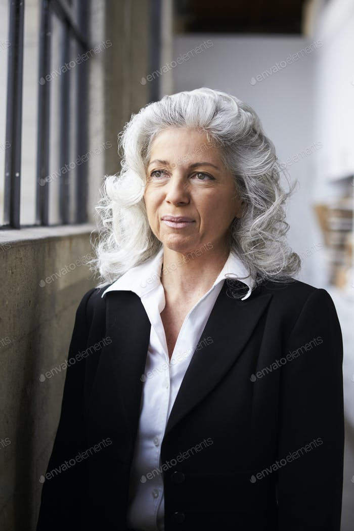 Senior white businesswoman looking away, portrait