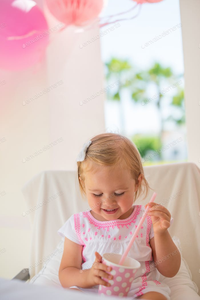 Cute Little Girl Holding Paper Pink Cup
