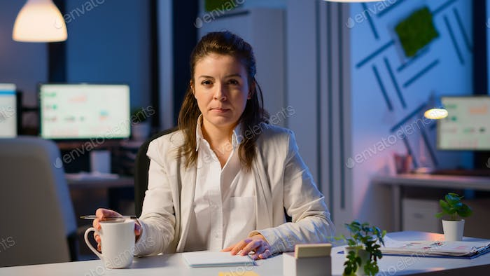 Businesswoman discussing during video conference working at midnight